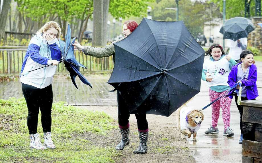 Candice Opie, left, 16, of North Branford gets help with her umbrella from her mother, Tabitha, during the 13th annual Sharon's Ride. Run. Walk for Epilepsy at the West Haven boardwalk on May 13, 2017. Photo: Arnold Gold-New Haven Register