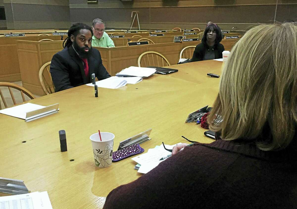 New Haven Acting Assessor Alex Pullen speaks to Finance Committee members during a scheduled meeting on the 2016 city grand list Monday at City Hall.