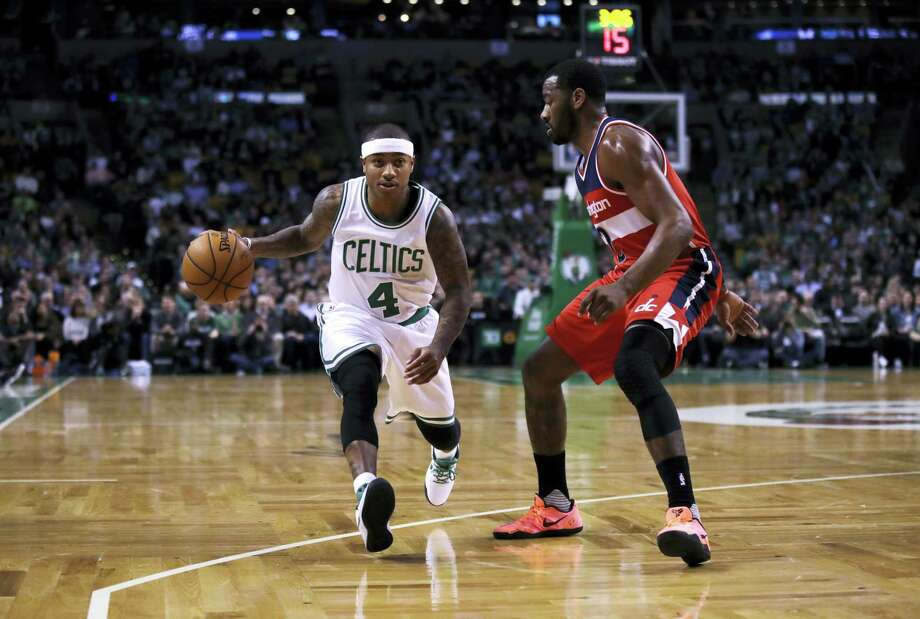 Boston Celtics guard Isaiah Thomas (4) dribbles the ball during the first quarter of NBA basketball game in Boston, Wednesday, Jan. 11, 2017. Photo: AP Photo/Charles Krupa   / AP