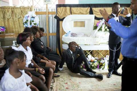 Grieving Haitians go into lifetime of debt to fund funerals - New