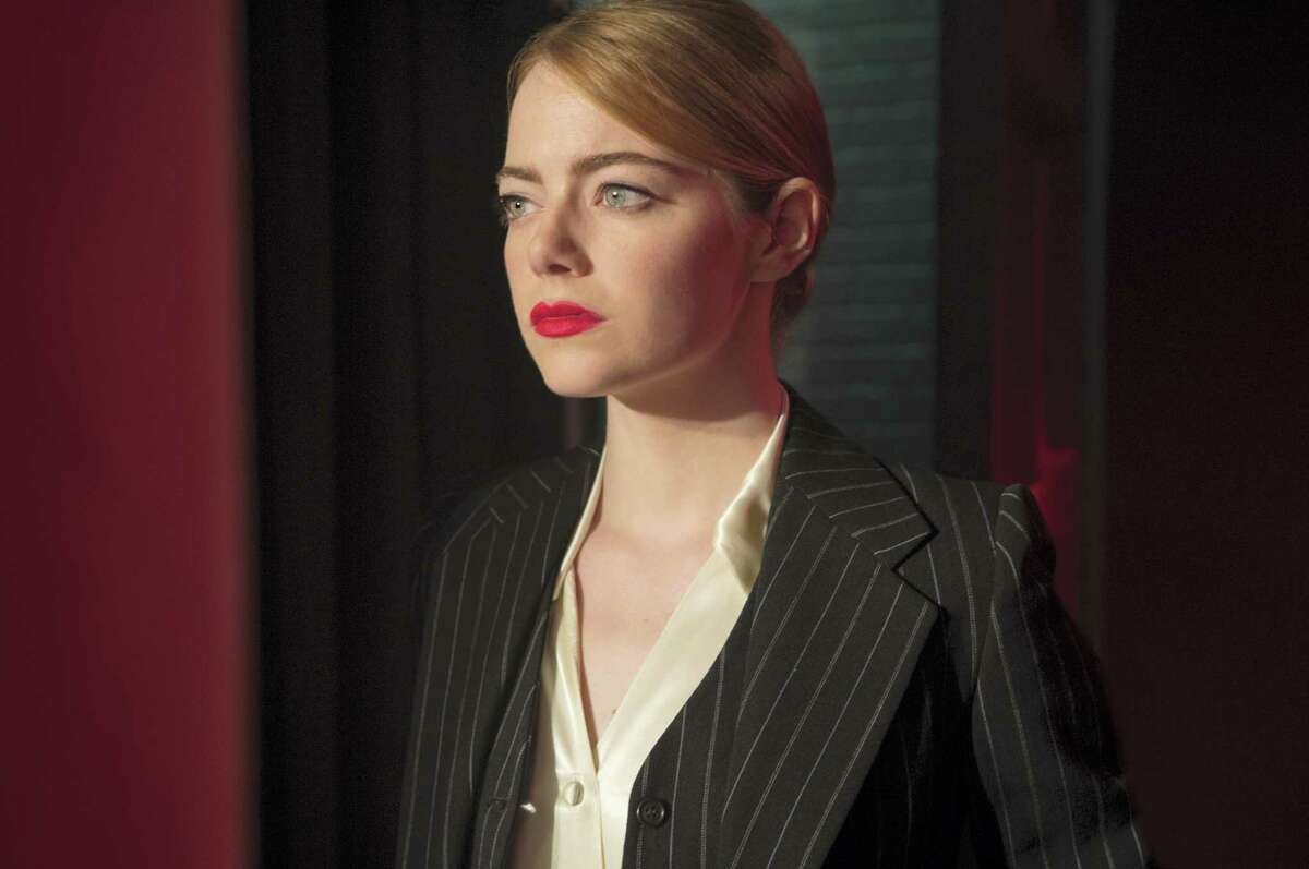 """This image released by Lionsgate shows Emma Stone in a scene from, """"La La Land."""" Stone was nominated for an Oscar for best actress in a leading role on Tuesday, Jan. 24, 2017, for her work in the film. The 89th Academy Awards will take place on Feb. 26."""