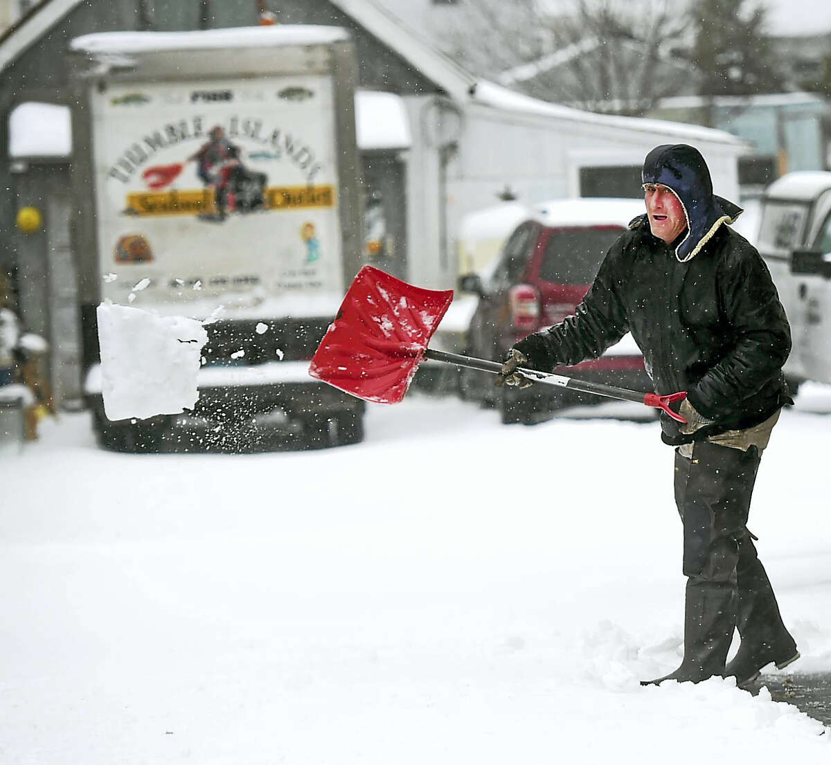Mike Torelli clears a driveway on Harrison Street in Branford during the snowstorm Tuesday.