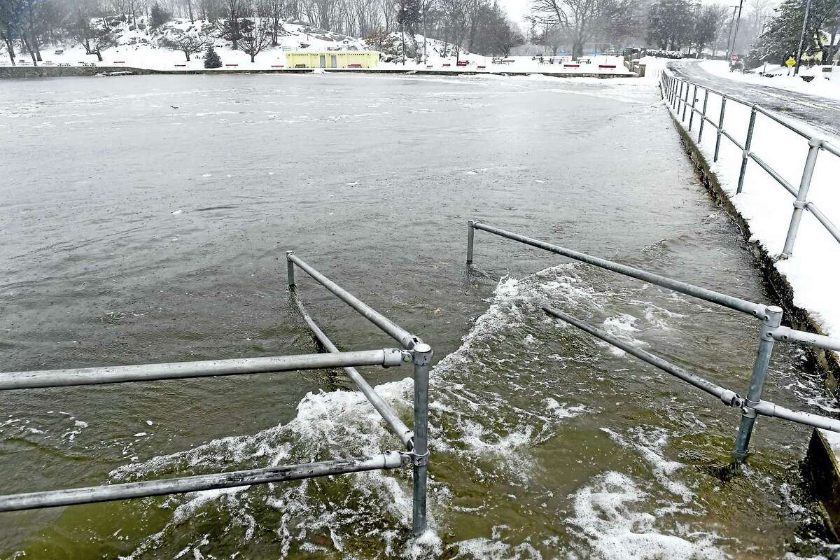 Peter Hvizdak — New Haven Register Extra high tide covers the whole beach at Branford Point in Branford during the snowstorm Tuesday.