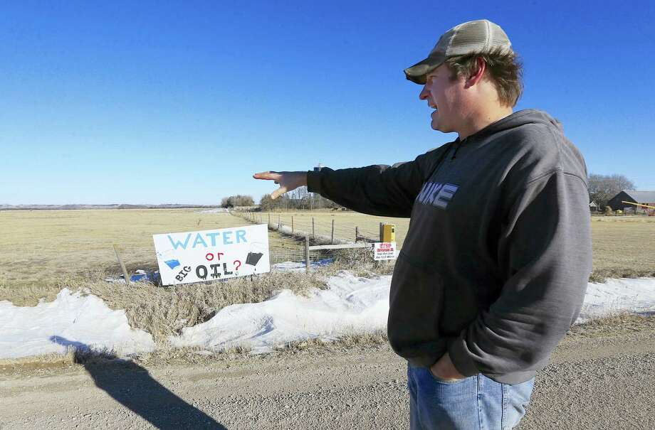 In this Jan. 16, 2015, file photo, Jim Tarnick of Fullerton, Neb., points to the route of the Keystone XL pipeline which is planned to run through his property. President Trump's decision to restart the Keystone XL pipeline approval process was disheartening but not surprising to Tarnick, who told the Associated Press on Tuesday, Jan. 24 that he and other landowners who oppose it will continue to fight, although he hopes he doesn't have to do it for the rest of his life. Photo: AP Photo/Nati Harnik, File    / Copyright 2017 The Associated Press. All rights reserved.