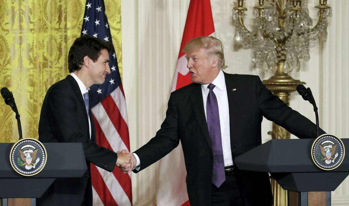 President Donald Trump and Canadian Prime Minister Justin Trudeau shakes hands during their joint news conference in the East Room of the White House, Monday in Washington.