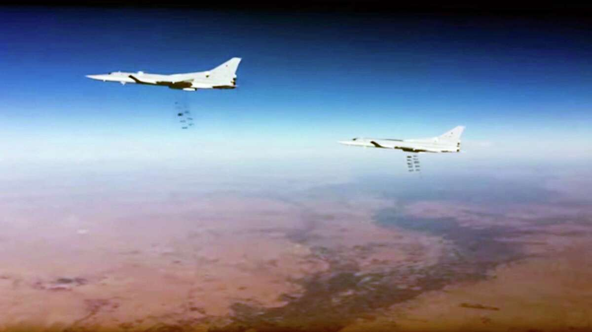 This photo provided by the Russian Defense Ministry Press Service shows Russian air force Tu-22M3 bombers strike the Islamic State group wldtargets in Syria on Tuesday, Jan. 24, 2017. The mission, the third such bombing raid in four days, targeted the Islamic State group around Deir el-Zour in eastern Syria where the Islamic State group has launched an offensive against Syrian government forces.