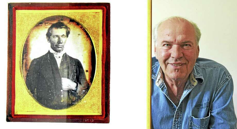 Joseph Buberger of Hamden, a daguerreotype photographic expert and historian, with a reproduction of a daguerreotype, circa 1843, of what is believed to be the earliest image of Abraham Lincoln. Photo: Peter Hvizdak — New Haven Register   / ©2017 Peter Hvizdak