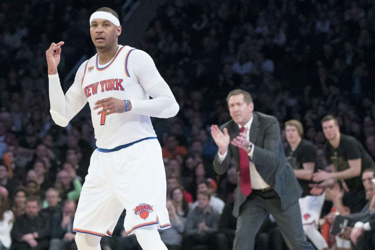 New York Knicks forward Carmelo Anthony (7) and coach Jeff Hornacek react after Anthony scored a 3-point goal during the second half of an NBA basketball game against the Denver Nuggets on Feb. 10, 2017 at Madison Square Garden in New York. The Nuggets won 131-123.