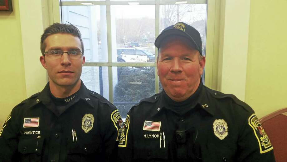 Left to right, Amity School Resource Officer Scott Prentice and Beecher Road School Resource Officer Vincent Lynch at a recent special meeting of the Board of Police Commissioners. Photo: Pam Mcloughlin - New Haven Register