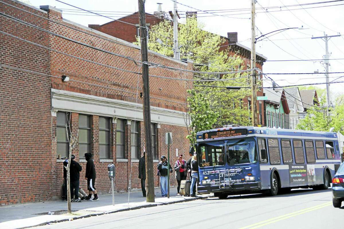 Anna Bisaro — New Haven Register A bus stop across the street from an APT Foundation treatment center on Congress Avenue is always crowded, New Haven police say. Police have concerns about the number of people always in the area of the treatment center.