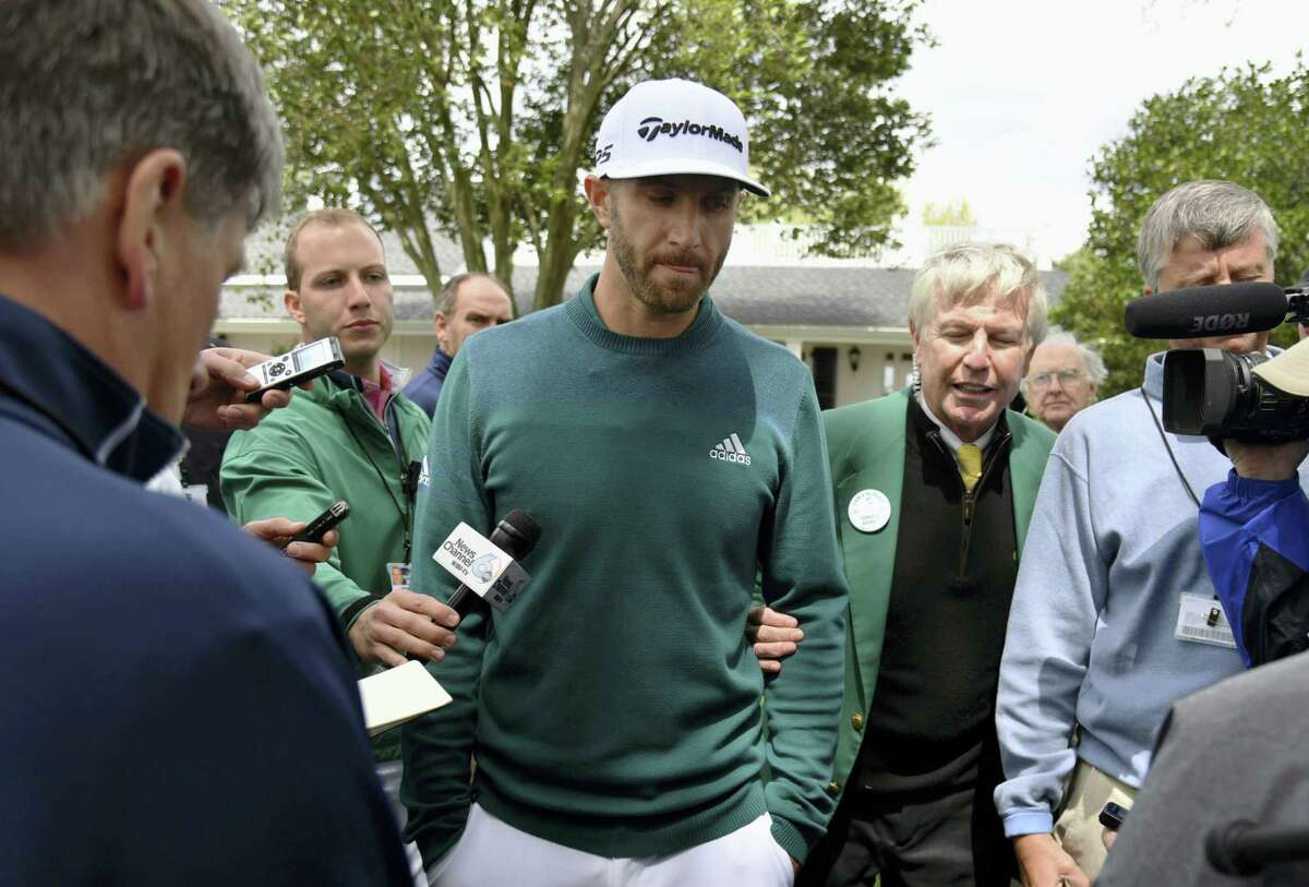 Dustin Johnson talks with media at Augusta National Golf Club Thursday.