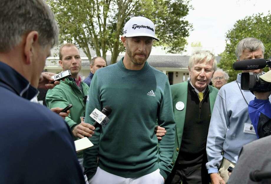 Dustin Johnson talks with media at Augusta National Golf Club Thursday. Photo: Brant Sanderlin — Atlanta Journal-Constitution Via AP   / 2017 Atlanta Journal-Constitution