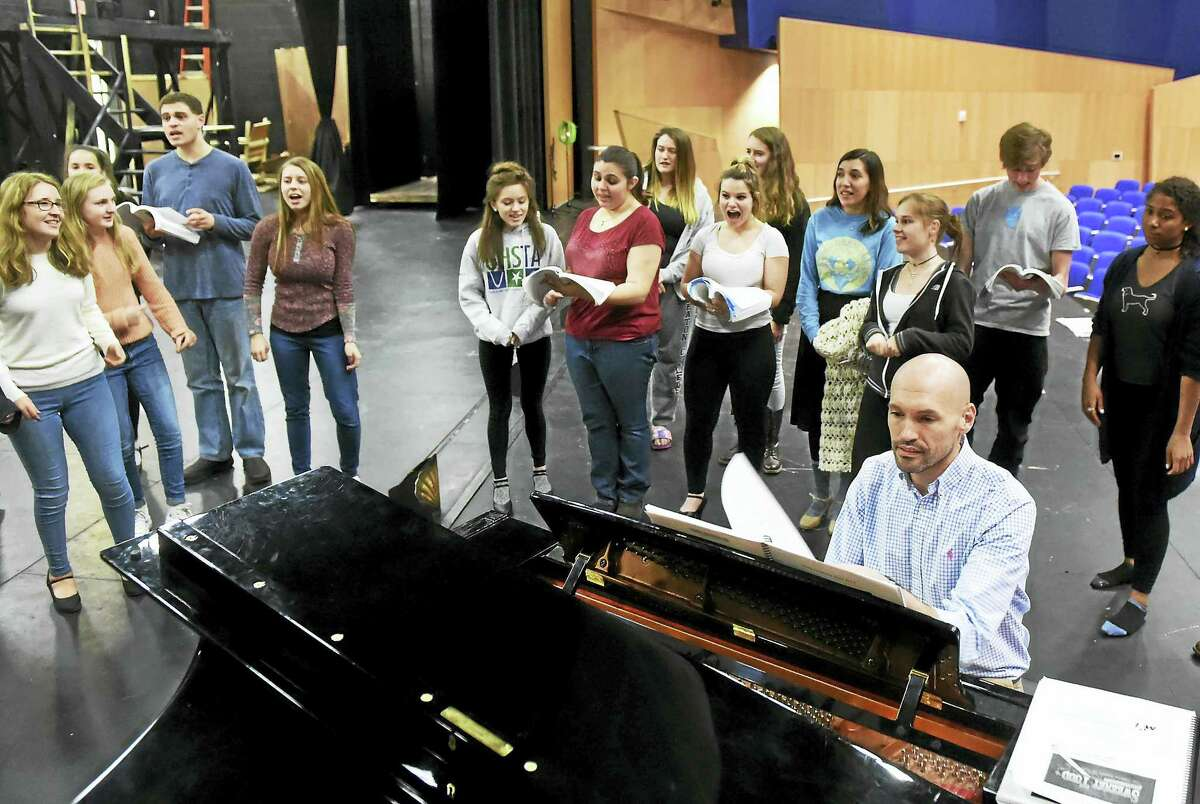 """Musical director Kevin Buno, the Guilford High School choral director, runs through the music for the show """"Sweeney Todd"""" during rehearsal with students in the auditorium at Guilford High School."""