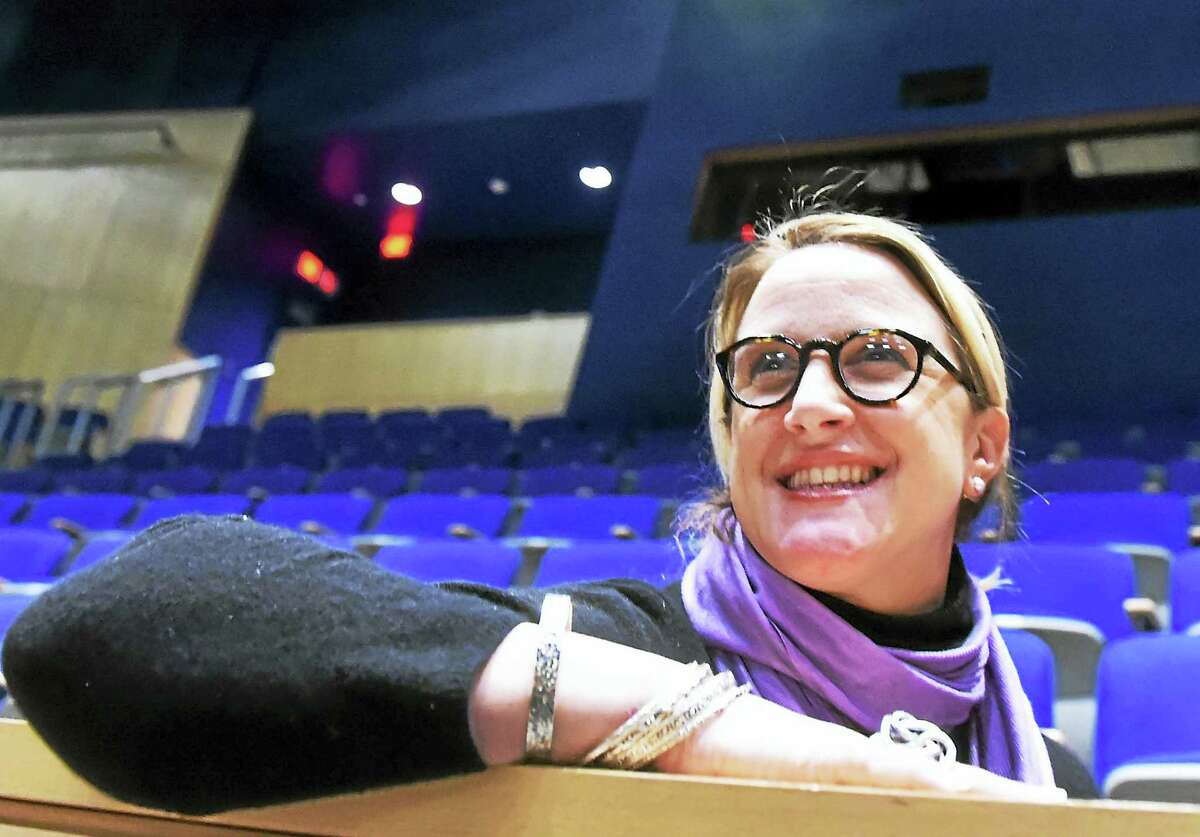 """Director Cara Mulqueen-Teasdale, the Guilford High School theatre arts director, watches the rehearsal for the show """"Sweeney Todd"""" in the auditorium at Guilford High School."""