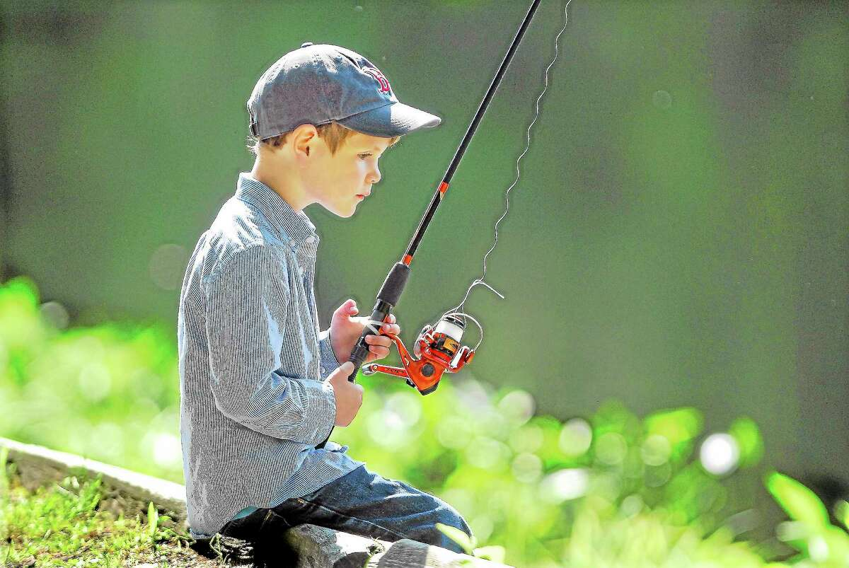 Catherine Avalone | File photo A young boy fishes at Chatfield Hollow in Killingworth.