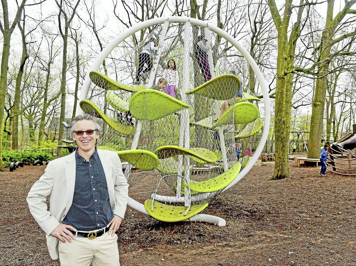 Spencer Luckey, of Luckey Climbers, next to one of his creations at the Foote School in New Haven.