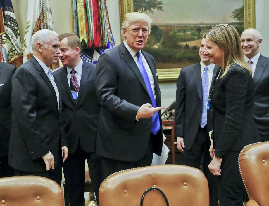 President Donald Trump gestures toward GM CEO Mary Barra, right, before the start of a meeting with automobile leaders in the Roosevelt Room of the White House in Washington Tuesday. From left are Vice President Mike Pence, left, and Matt Blunt, president of the American Automotive Policy Council and the former governor of Missouri. Photo: Pablo Martinez Monsivais — The Associated Press   / Copyright 2017 The Associated Press. All rights reserved.
