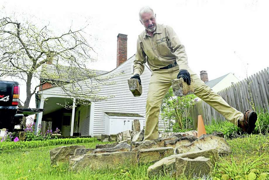 """(Peter Hvizdak - New Haven Register)  Master Stone Artisan Andrew Pighills of English Gardens and Landscaping of Killingworth place pieces of a mid-19th century historic smokehouse dismantled from its original location at the St. Alexis  Orthodox Church in Clinton to its new location behind the """"Old Brick"""" house of the Clinton Historical Society. Photo: ©2017 Peter Hvizdak / ?2017 Peter Hvizdak"""