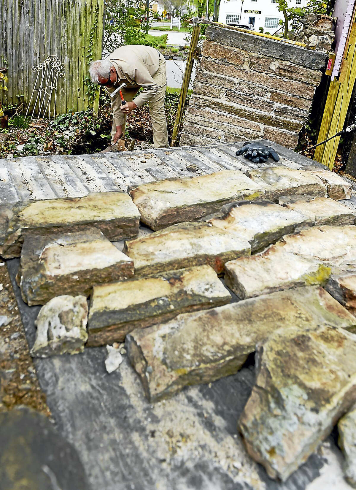 (Peter Hvizdak - New Haven Register) Master Stone Artisan Andrew Pighills of English Gardens and Landscaping of Killingworth dismantles a mid-19th century historic smokehouse at the St. Alexis Orthodox Church in Clinton.