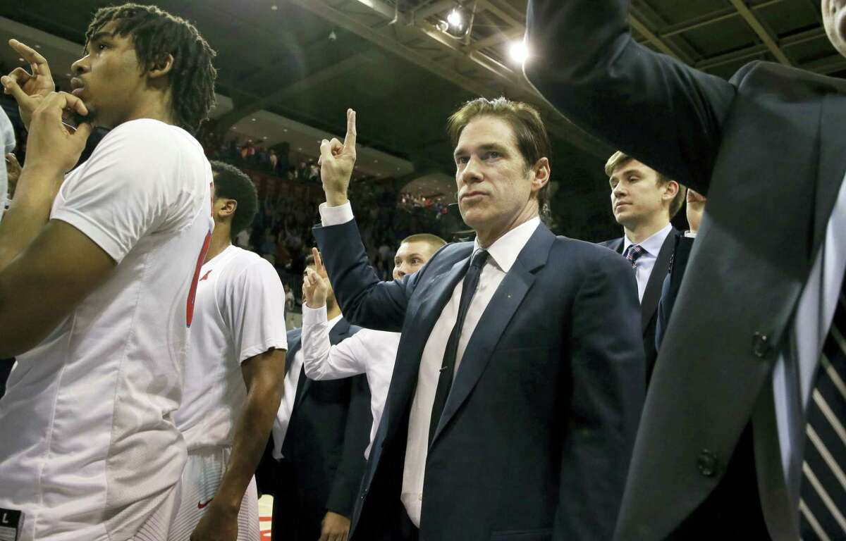 SMU head coach Tim Jankovich stands on the court after Sunday's win over Cincinnati.