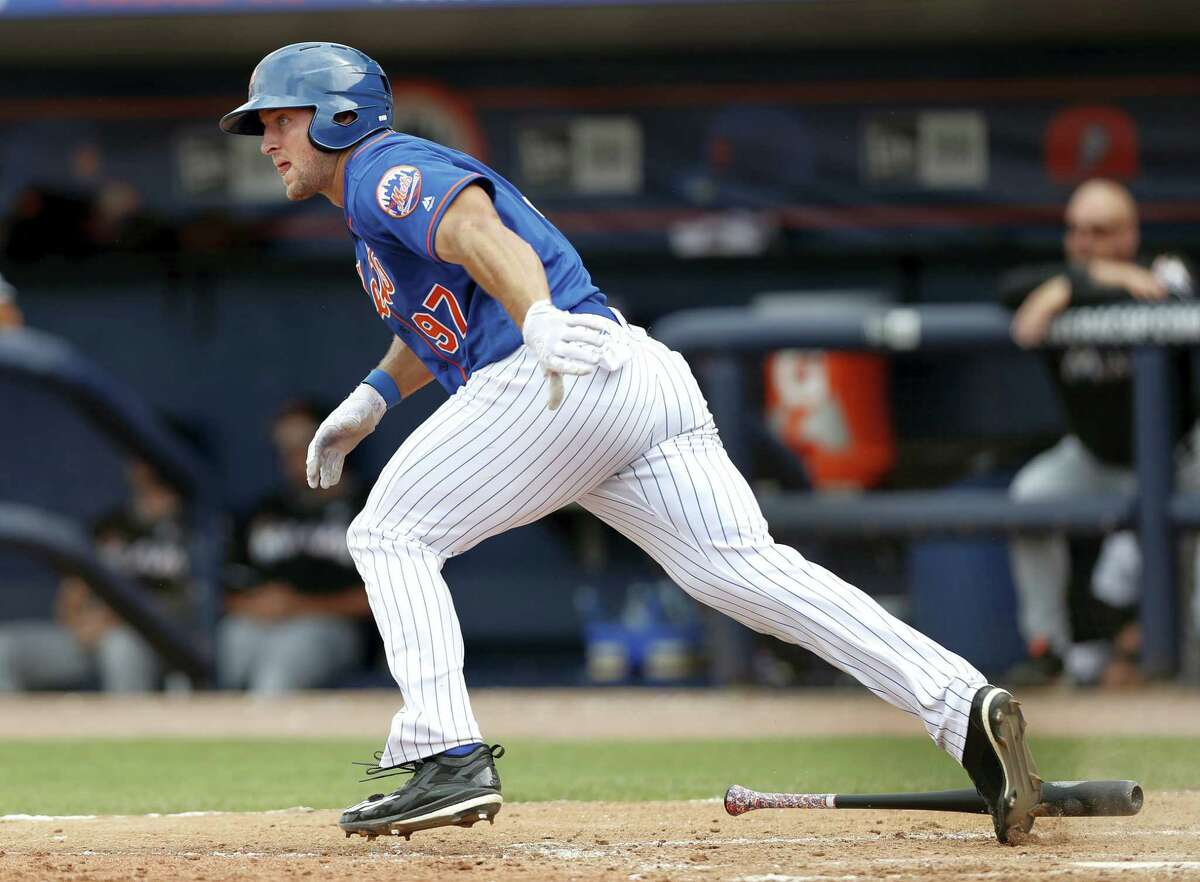Tim Tebow runs to first during a spring training game.