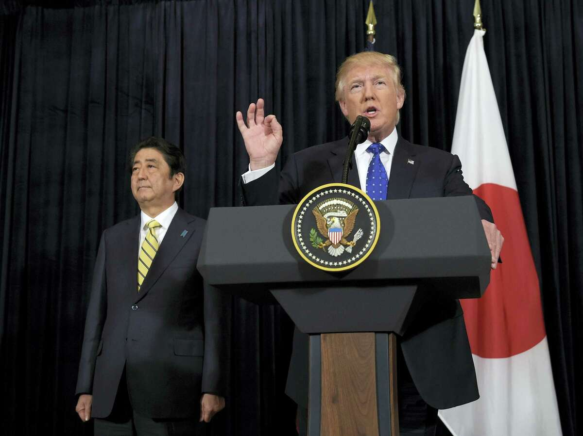 President Donald Trump speaks as Japanese Prime Minister Shinzo Abe listens as they both made statements about North Korea at Mar-a-Lago in Palm Beach, Fla. on Saturday, Feb. 11, 2017.