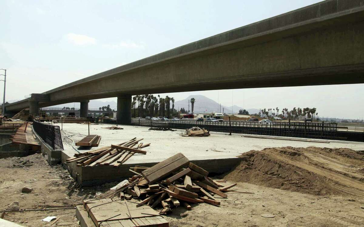 In this Sept. 14, 2009 photo, road construction begins along California interstate 215 north in San Bernadino County. The construction was undertaken with help from the 2009 federal stimulus package. President Donald Trump said on April 4, 2017 he was unaware of anything that was built from that stimulus.