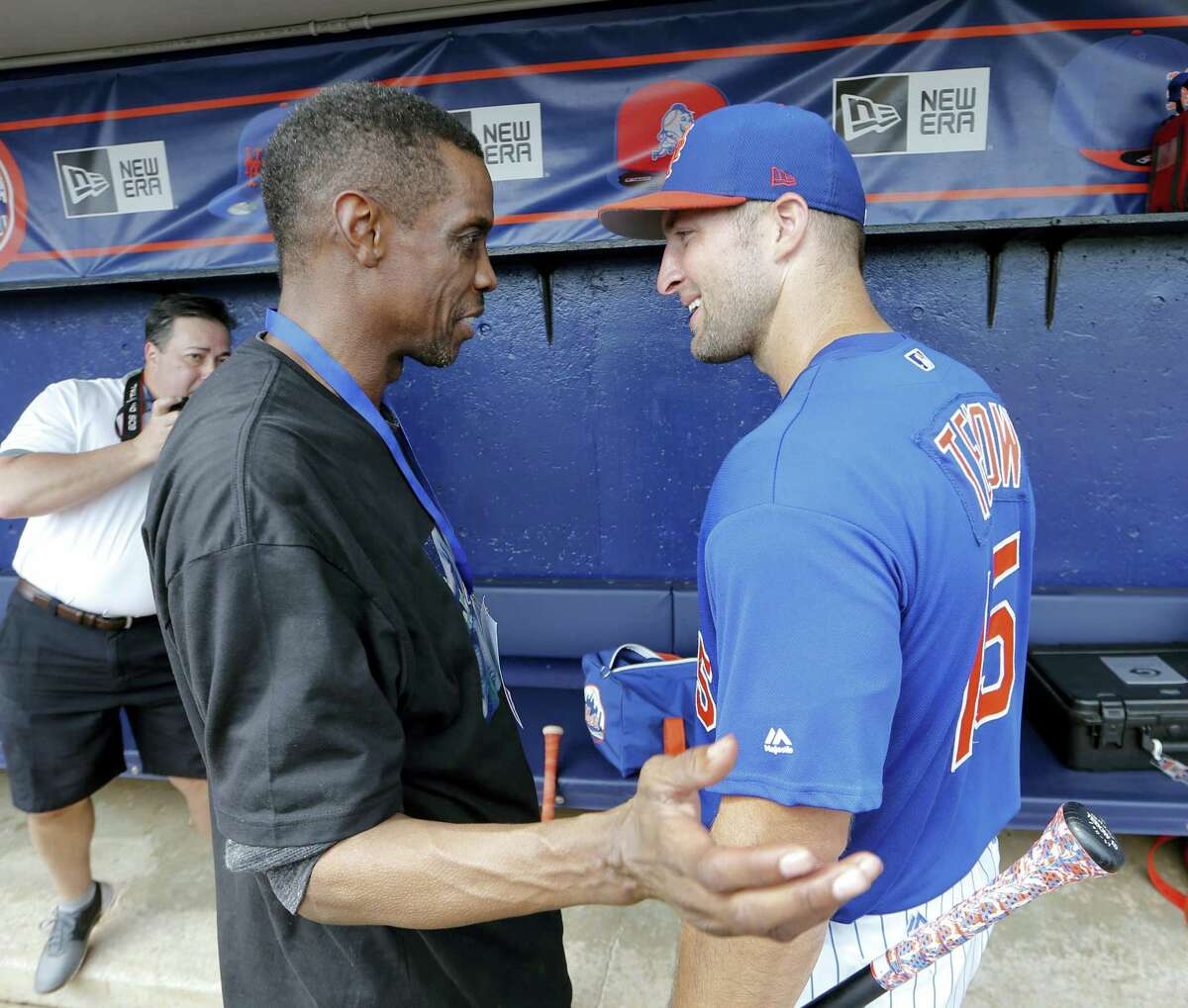 Tim Tebow, right, talks with former Mets pitcher Dwight Gooden before a spring training game Monday in Port St. Lucie, Fla.