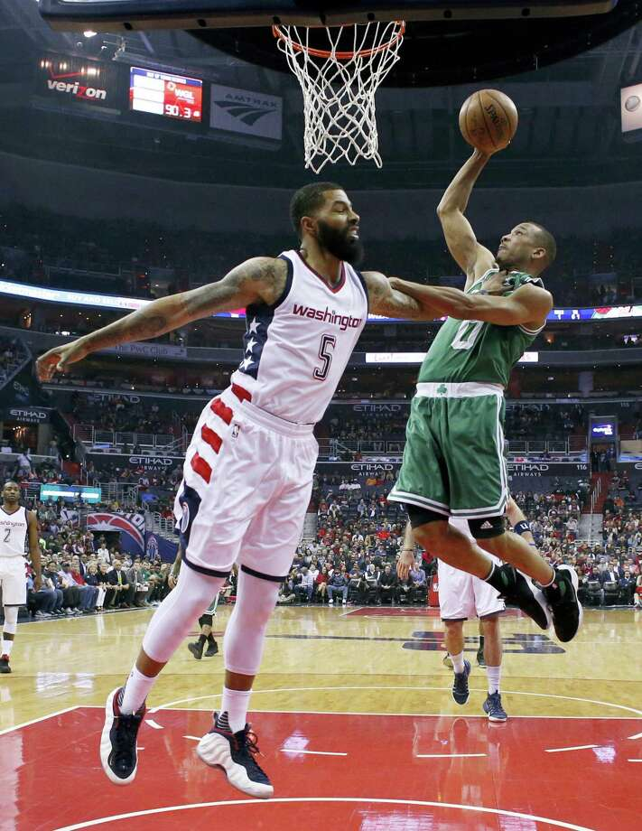 Celtics guard Avery Bradley, right, shoots over Wizards forward Markieff Morris during the first half Friday. Photo: Alex Brandon — The Associated Press   / Copyright 2017 The Associated Press. All rights reserved.