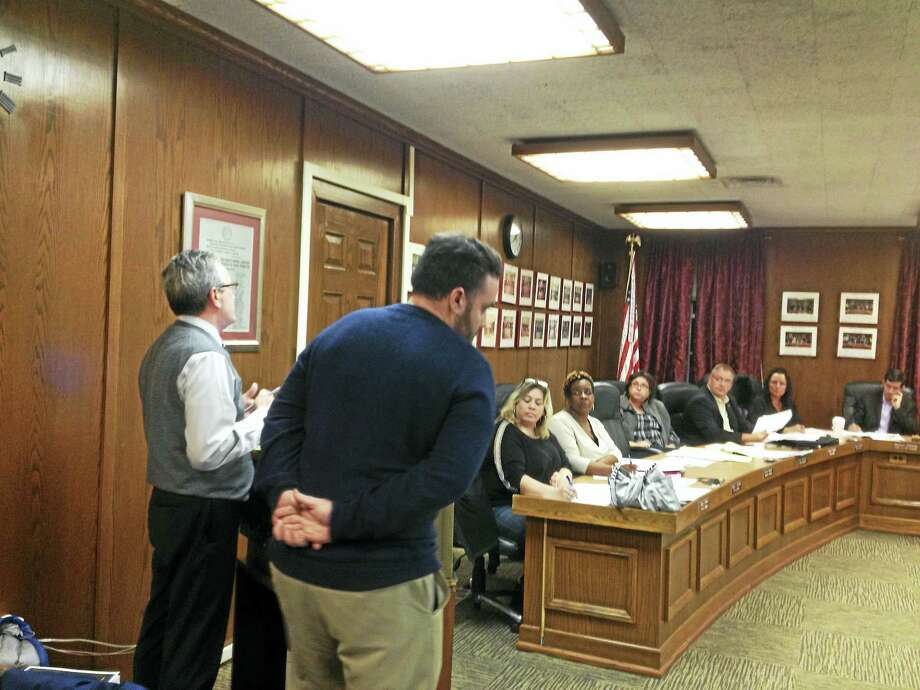 West Haven Superintendent of Schools Neil Cavallaro, far left, and schools Business Manager Matt Cavallaro address the City Council Monday night regarding the Board of Education's finances. Photo: Mark Zaretsky - New Haven Register