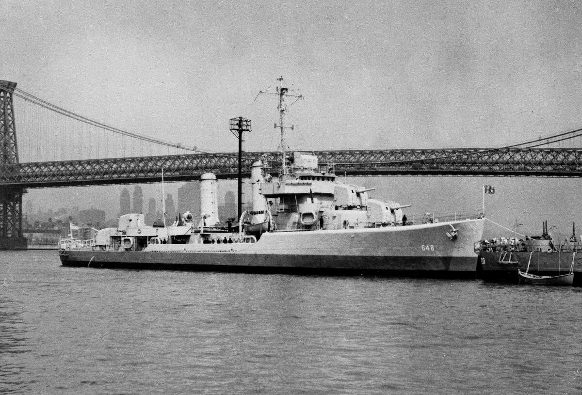 This undated photo provided by the U.S. Navy shows the USS Turner on the East River in New York City near the Williamsburg Bridge. The USS Turner exploded and sank in 1944 and more than 130 of its sailors are still listed as missing. The Pentagon said that it will try to determine if dozens of sailors listed as missing were actually recovered and buried all along as unknowns in a New York cemetery.