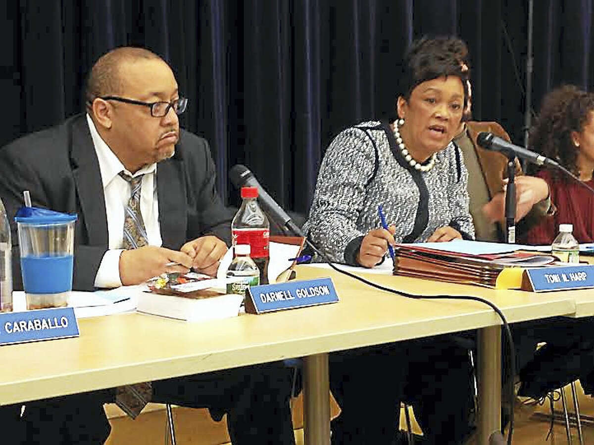 Board of Education member Darnell Goldson, left, and Mayor Toni Harp, right, at a board meeting.