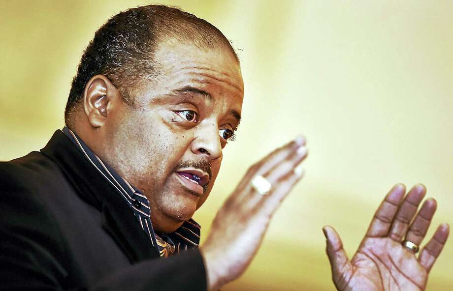 "Roland Martin, host and managing editor of News One Now and senior analyst for the ""Tom Joyner Morning Show,"" speaks at Thursday's centennial celebration. Photo: Catherine Avalone — New Haven Register   / Catherine Avalone/New Haven Register"