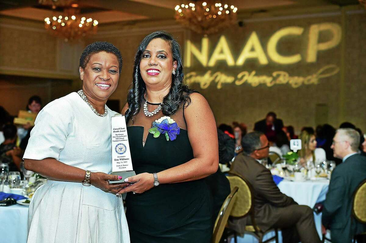 Doris J. Dumas, president of the Greater New Haven Branch of the NAACP, right, presents the Cornell Scott Health Award to Ena Williams Thursday at the group's annual Freedom Fund Dinner at the Omni New Haven Hotel at Yale. Williams, a registered nurse, came to the U.S. from Jamaica in 1992 and currently serves as the vice president/associate chief nursing officer for patient services at Yale New Haven Hospital.