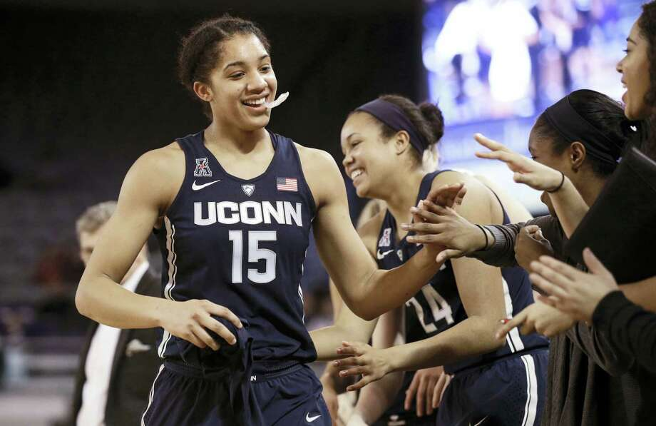 UConn's Gabby Williams (15) is congratulated by teammates after achieving a triple-double, the fifth in school history, during the second half of the Huskies' 91-44 win, the program's record 94th straight victory. Photo: GERRY BROOME — THE ASSOCIATED PRESS   / Copyright 2017 The Associated Press. All rights reserved.