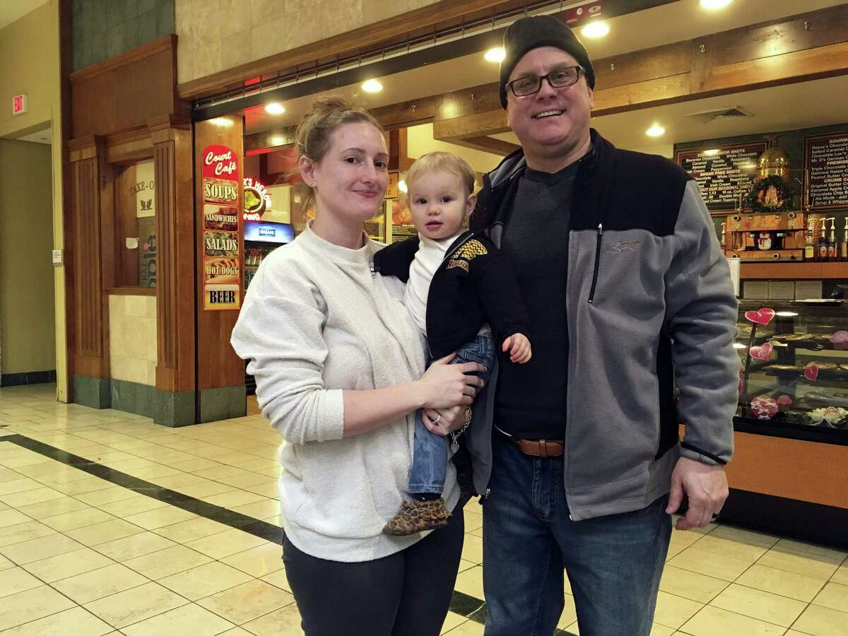 Stormy Patterson and her husband, Roger Kornfeind, pose for a portrait with their 16-month-old daughter, Rowan, at a mall in Whitehall, Pennsylvania, on February 9, 2017. Patterson has boycotted Hobby Lobby for years over the chain's stance on birth control, a phenomenon that seems to be gaining steam in the Donald Trump era as activists who either oppose or support the president target stores and brands for boycotts.