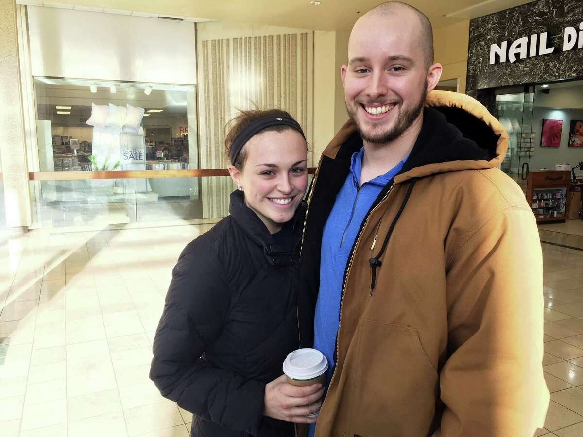 Courtney Taylor and her boyfriend, Zach Tobias, pose for a portrait at a mall in Whitehall, Pennsylvania, on Feb. 9, 2017. Taylor and Tobias don't mix shopping with politics, but say it seems to be happening more often during the Donald Trump era as activists who either oppose or support the president target stores and brands for boycotts.