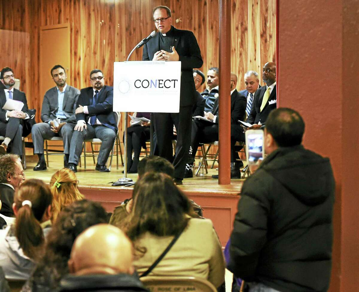 The Rev. James Manship of St. Rose of Lima Catholic Church in New Haven and the o-chairman of CONECT's Strategy Team, speaks during a Congregations Organized for a New Connecticut (CONECT) solidarity assembly at the New Haven church Tuesday.
