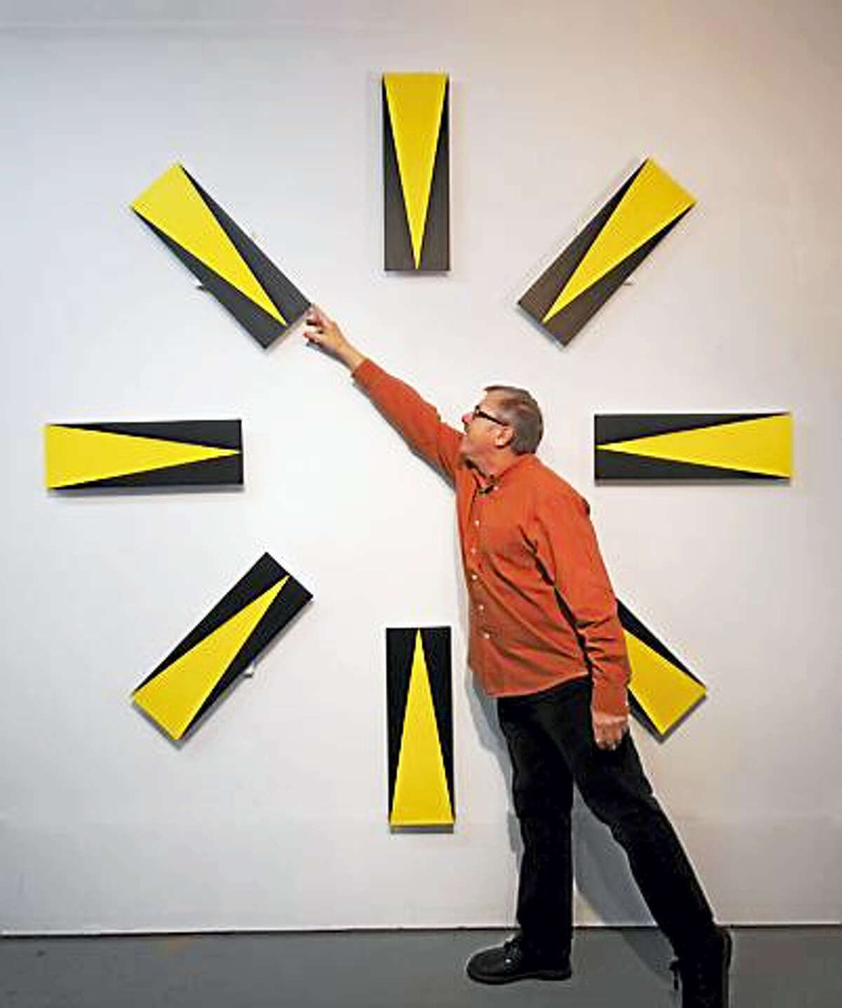 Bob Gregson and his hands-on clock.