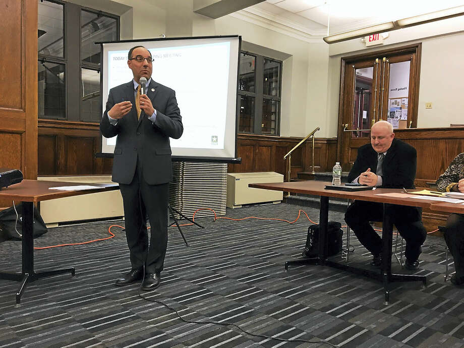 MARY E. O'LEARY — NEW HAVEN REGISTER  Deputy Economic Development Administrator Michael Piscitelli addresses a hearing on dredging New Haven Harbor Tuesday in New Haven. Photo: Digital First Media