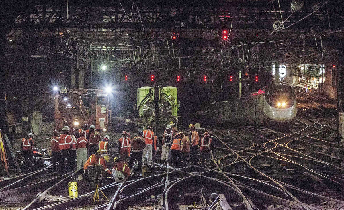 In this Wednesday, April 5, 2017, photo provided by Amtrak, workers repair rails inside New York's Penn Station. Amtrak says it hopes to restore full service to New York's Penn Station by Friday, four days after a second derailment in less than two weeks. Monday's derailment of a New Jersey Transit commuter train damaged switches, signals and rails at a spot where two tracks emerge from a tunnel and diverge to 21 tracks.