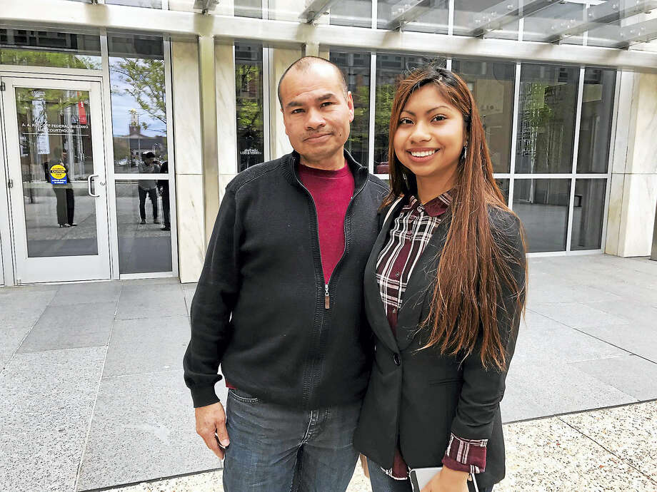 Luis Barrios and his daughter, Jessica, are seen in Hartford after he had his GPS tracking device removed Friday. Photo: Esteban L. Hernandez — New Haven Register