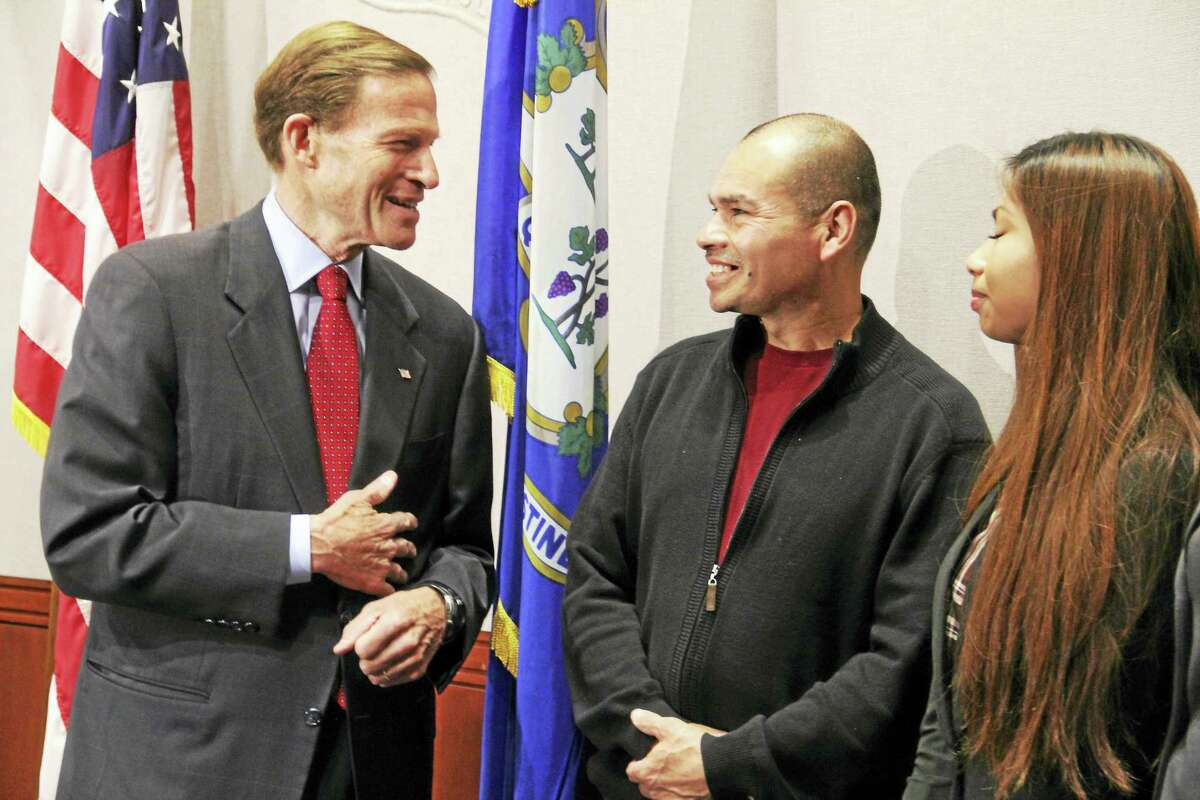 U.S. Sen. Richard Blumenthal, left, stands next to Derby resident and undocumented immigrant Luis Barrios while Barrios' daughter, Jessica, looks on following a press conference Friday at the Legislative Office Building in Hartford.