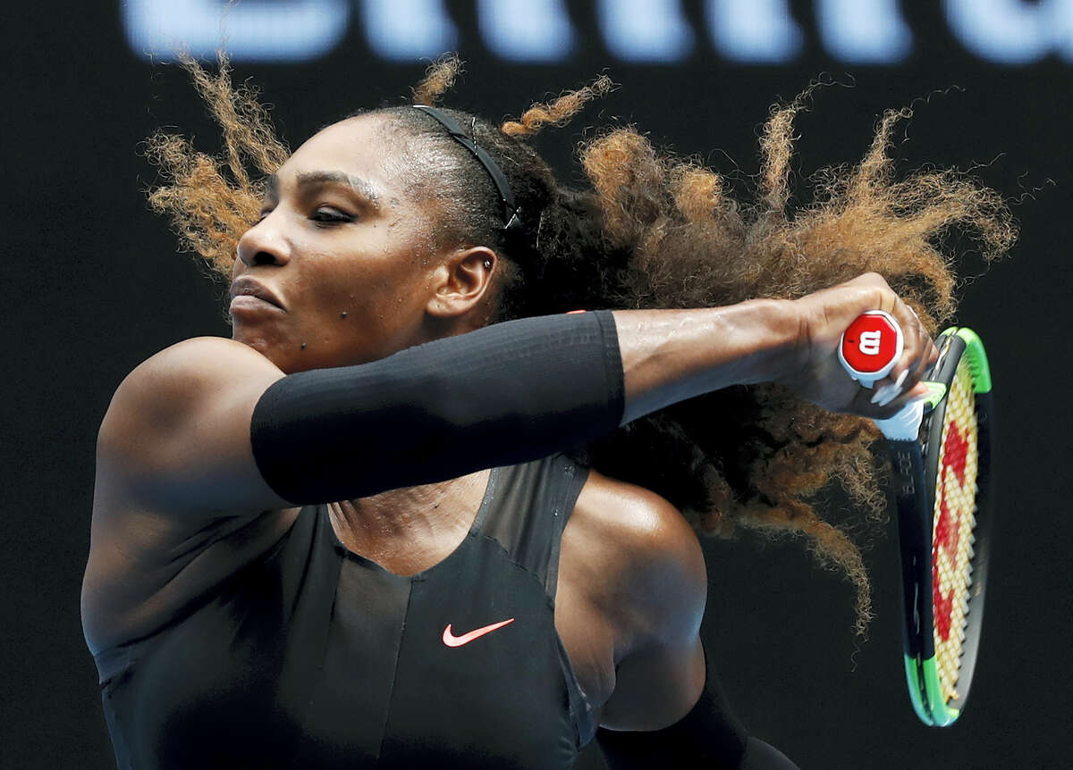 United States' Serena Williams makes a forehand return to Barbora Strycova of the Czech Republic during their fourth round match at the Australian Open tennis championships in Melbourne, Australia on Jan. 23, 2017.