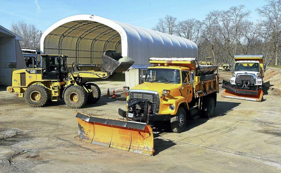 Plows are filled with a molasses/salt mixture at the Milford Public Works Department on Monday to pretreat roads in preparation for the impending snowstorm. Photo: Arnold Gold — New Haven Register