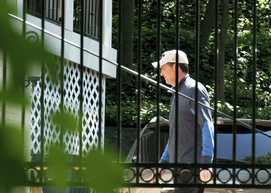 Former FBI Director James Comey walks at his home in McLean, Va., Wednesday, May 10, 2017. President Donald Trump fired Comey on Tuesday, ousting the nation's top law enforcement official in the midst of an investigation into whether Trump's campaign had ties to Russia's election meddling. Photo: AP Photo/Sait Serkan Gurbuz    / FR171401 AP