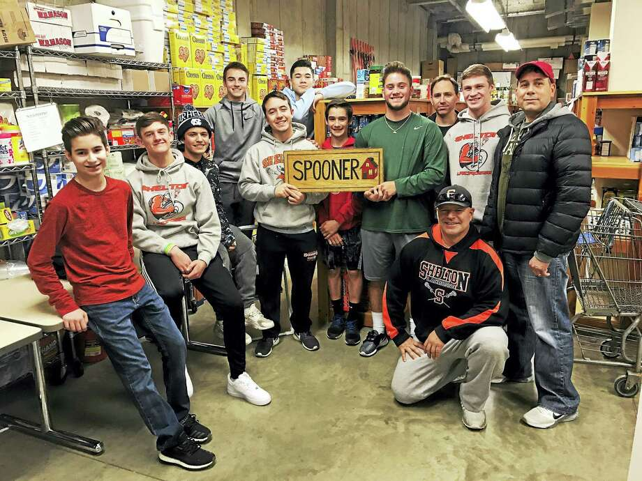 Shelton High School's Boys Lacrosse Team with donations at Valley Food Bank Photo: Contributed Photo — Spooner House