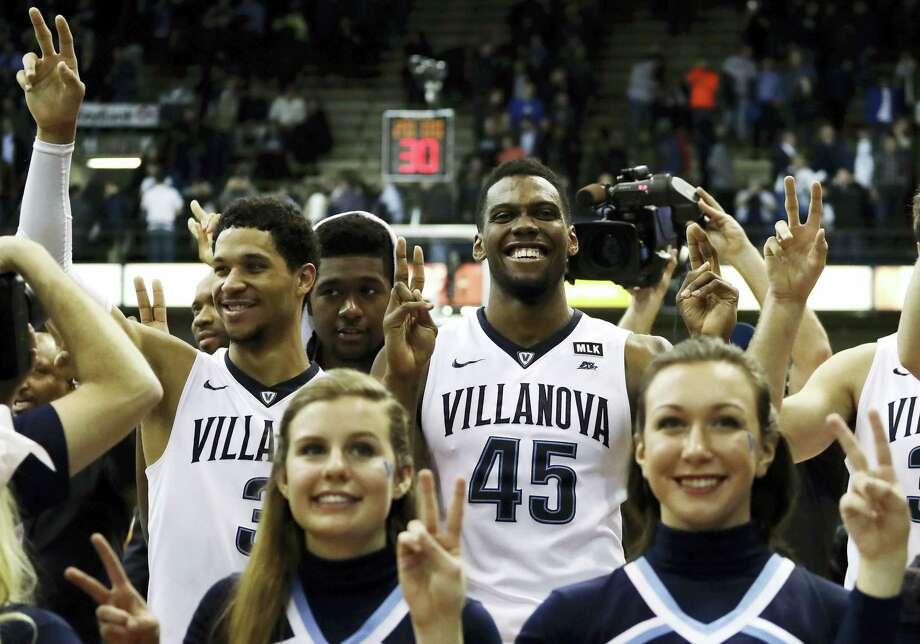 From left, Villanova's Josh Hart, Kris Jenkins and Darryl Reynolds celebrate after winning a game against Seton Hall. Photo: The Associated Press File Photo   / Copyright 2017 The Associated Press. All rights reserved.