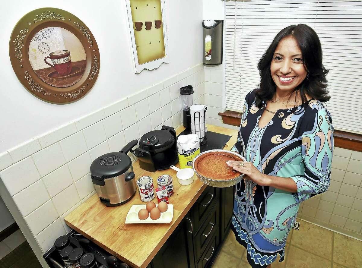 Johanna Torres makes a flan in her Branford kitchen.