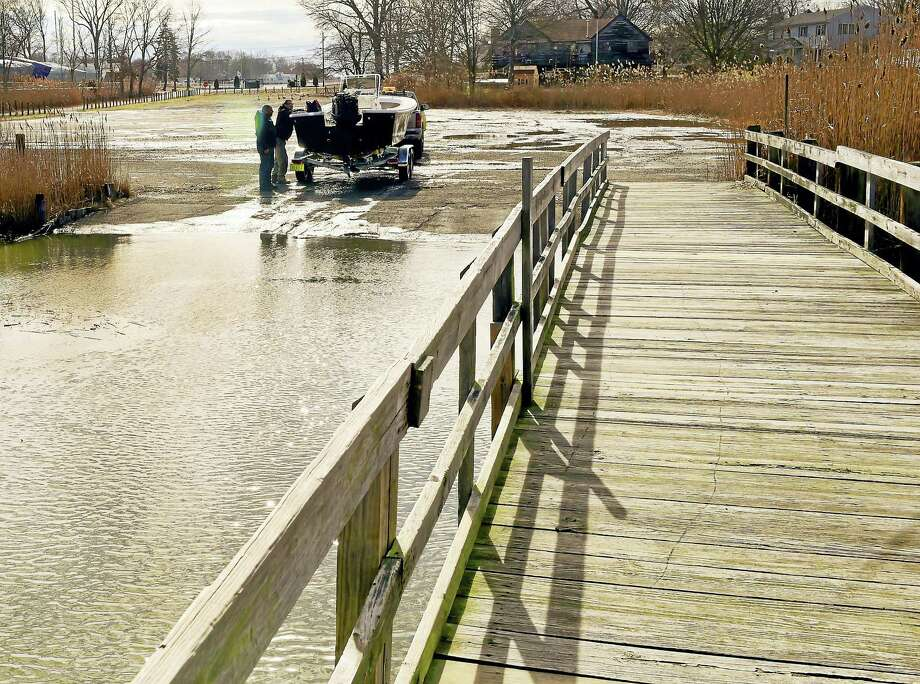 Chris Goodl and Gared Grodske of Diamond Marine of East Haven run a test on a motorboat engine at the Branford River Boat Launch on Goodsell Point Road in Branford. Photo: Peter Hvizdak — New Haven Register File Photo   / ©2016 Peter Hvizdak